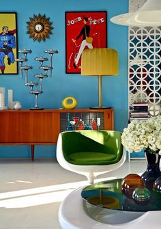 Blue wall with vintage sideboard and Cognac chair