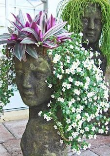 CiNdEeS' GaRdEn: Wordless Wednesday...Garden Head Planters