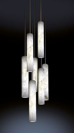 SUMATRA Each cylinder is suspended by a metal rod- the structural support which also contains the electrical components. These rods come in varying finishes to either diminish their appearance, or highlight their presence as an overall component to the piece. The alabaster element is available in two sizes: 50 x 8 cm, or 80 x 13 cm