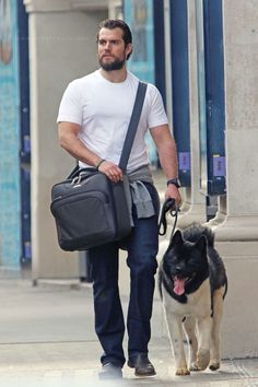 Henry Cavill walking his pooch.