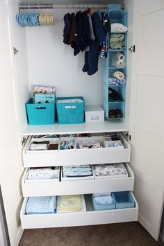Nursery organization! Love the hanging soft shelfs for blankets and towels