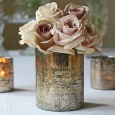 For a luxe wedding this chunky bronze vase filled with vintage roses looks oh so elegant.  Available from www.theweddingofmydreams.co.uk @Matty Chuah Wedding of my Dreams #wedding #centrepiece #vase