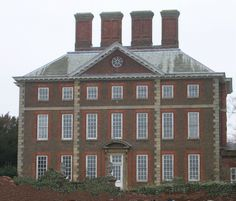 Winslow Hall in Buckinghamshire, 1700 and probably by Christopher Wren, has most of the typical features of the original English style
