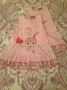 Maggie Peggy 2 (2T). Super sweet pink cotton dress with house appliqué and other details.  Zips in back with tie too.  $5 each