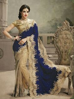 Awesome saree made with half net & half micro velvet. It is available in Golden+Red/Maroon/Navy Blue.