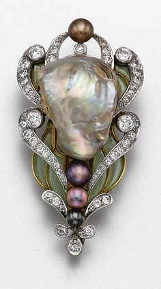 BAROQUE PEARL, PLIQUE-À-JOUR ENAMEL AND DIAMOND BROOCH, MARCUS & CO., CIRCA 1900. The stylized floral motif decorated with a baroque pearl of pale gray color with pastel overtones, and with 4 smaller pearls of aubergine, black and bronze hue, framed by scrolls of old European-cut diamonds and leaves of green plique-à-jour enamel, mounted in 18 karat gold, signed Marcus & Co.