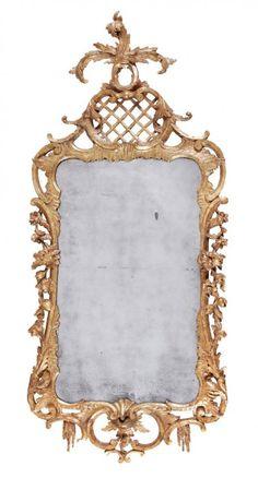 A George II carved giltwood wall mirror, circa 1735,
