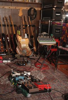 Guitar and electric bass music studio station with storage racks including for cables, pedal board, amp stack, mixing board. And an oriental rug to absorb sound (and keep us from slipping when we excitedly move around while rocking out:) #DdO:) MOST POPULAR RE-PINS - http://www.pinterest.com/DianaDeeOsborne/instruments-for-joy/ - INSTRUMENTS FOR JOY, via cSw - http://www.pinterest.com/claxtonw/4-5-6-strings/ - 'Jazzmaster' photo pin via Benjamin Fargen.