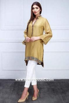 Color: Gold Fabric: Raw silk Work Details: Embroidered PRODUCT DETAILS A golden olive, cotton net shirt designed with embroidery on the neckline and hemline. Silk Kurti Designs, Kurta Designs Women, Kurti Designs Party Wear, Stylish Suit, Stylish Dresses, Casual Dresses For Women, Clothes For Women, Simple Pakistani Dresses, Pakistani Fashion Casual
