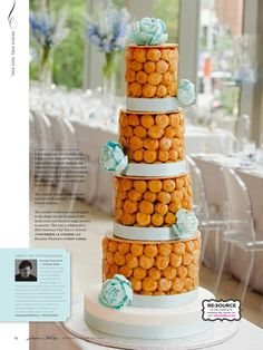 Croquembouche tower by french bakery Patisserie La Cigogne, blue flowers by Roxy Cakes