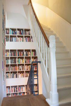 Staircase bookshelves.