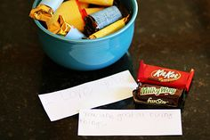 Simple Father's Day Gifts Kids Can Make via Simple Kids.... Special notes for Dad  from the kiddos wrapped in his favorite candies.... Such a sweet idea.