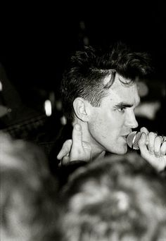 Morrissey on stage with The Smiths at Civic Hall, Guildford, England on February 28, 1985 -- photo by Innis McAllister.