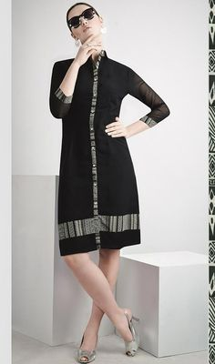 Feel as fresh and renewed as dew kissed grass by stepping into this black color printed georgette tunic. The ethnic printed work within the attire adds a sign of elegance statement with your look. #SexyBlackStraightCutTunic