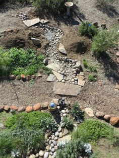 Creating a Dry Creek Bed - with Tips for a Natural Look  this pinner has a dry creek board...
