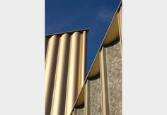 acid-etched precast concrete panel gallery facade - gold-anodised panel above - Nottingham Contemporary - Nottingham, UK - Caruso St John