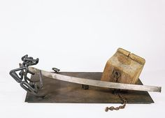 """Mark di Suvero, """"Silver Bow,"""" 1962.  Wood, iron and steel, 16 x 58 x 28 inches.  Private Collection."""