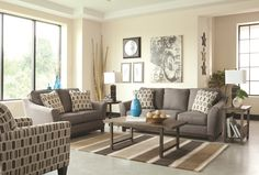 Clean Lines Define the Janley Slate Gray Pillow Back Sofa and Loveseat