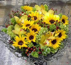 Sunflowers, Orchids, Coffee Berry, bells and celosia. Flower Factor