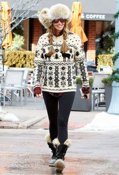 Elle Macpherson is a high-fashion snow bunny in this fur trapper hat, fair isle sweater and trimmed boots