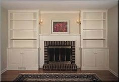 Built-in bookcases around a shallow gas fireplace