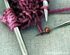 Adding beads to knitting - The great trick here is that using the teeny crochet hooks means you don't have to pre-string the beads on the yarn!