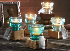 vintage tea lights; made from recylced glass with tied tags. great for #wedding tables.