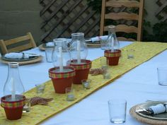 Centerpieces - Terracotta pot with sand, taper, and hurricane globe.  Plaid ribbon to decorate the rim.  ADORABLE!!