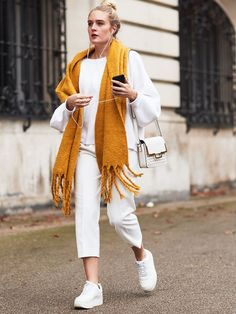 Four cool outfit ideas that demonstrate how to wear white jeans and look modern, from skinny white jeans to boyfriend denim.