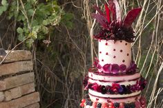 Jewel toned autumn wedding cake with edible flowers and berries
