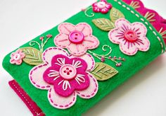 Love love. Love the pink and green, the felt applique, the little buttons and beads, love it.