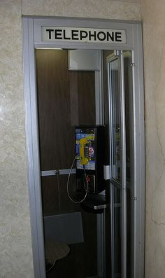 Old-time enclosed phone booth located in the Hall Of Records building, Fresno, California.     Hmm I like