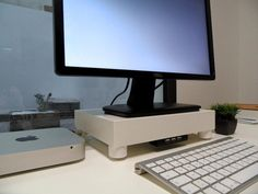 DIY / homemade monitor stand with Ikea furniture with built in USB hub.