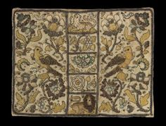 Book cover, English 1600-1650.  Silk embroidered with silk and gold colored metallic thread and spangles.