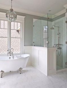 Master bath with walk-in shower, wainscoting, gray walls, white tiling