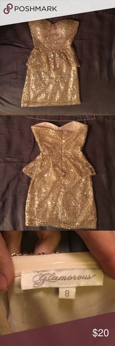 Gold Sequin dress Great for NYE, bachelorette party or fun night out! Was worn one and looks great in photos! Has a zipper up the back. The lining is a little stretchy. ****The tag says it is a size 8, but it fits like a size 0!!!!**** I remember them having a very off sizing chart when I ordered it. I wore it once when I was a size 0 and was a 32 B. Your boobs could be a little bigger but would not work for someone who is really busty. Glamorous Dresses Strapless