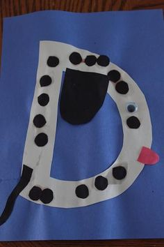 """D is for Dog.""  It's a Dalmatian with dots."