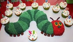 "Very Hungry Catepillar Birthday cake - Very Hungry Caterpillar Cake & Cupcakes for my 2 year old Granddaughter's Birthday! Made with bundt pan and 6"" round pan for the head.  I used what was left from the 6"" to round off the back end of the caterpillar."