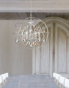 Crystorama 9028-OS-GS-MWP Solaris Chandelier with hand-painted wrought iron sphere and a crystal chandelier dressed with golden shade hand-cut crystals. 6 Light Chandelier