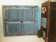 TV hidden behind vintage French shutters