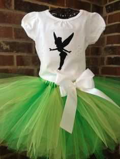 White top with fairy applique and rhinestone fairy dust paired with a nice and full hand-tied tutu with stretchy elastic waist. Tutu is topped Fairy Birthday Party, 3rd Birthday Parties, Baby Birthday, Tinkerbell Party, Tinkerbell Outfit, Tinker Bell Costume, Peter Pan And Tinkerbell, Zeina, Green Tutu