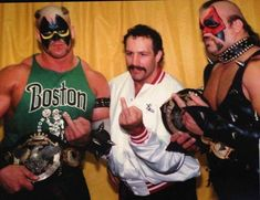 """The Road Warriors, Hawk and Animal with manager Paul Ellering give us all a """"Stone Cold"""" salute. Maybe we should change the name to """"The middle finger of Doom! Awa Wrestling, World Championship Wrestling, Japan Pro Wrestling, Wrestling Superstars, Bruiser Brody, The Road Warriors, Vince Mcmahon, Shawn Michaels, Wwe Tna"""