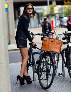 Olivia Palermo - Riding a bike wearing that??? Really?