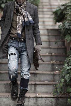 Mitsuru Strano: wool overcoat, silk scarf, suede shirt, ripped jeans, croc belt, wool gloves, lace up boots, beard, LV satchel.