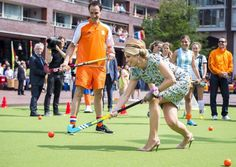 Playing hockey. Queen Maxima