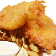 A battered fish recipe that is best served with tartar or hot sauce.