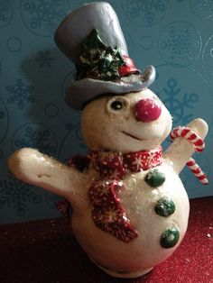 From a cute ETSY shop TZLITTLECHRISTMASELF Yule is a one of a kind paper clay sculpture. He joyfully welcomes the falling snow. He measures a hair under 6 1/2 inches tall and 3 inches at his widest point.