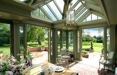 A beautiful English conservatory overlooking the sunny countryside