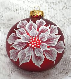 Rich Red glass ornament with White 3D texture painted MUD poinsettia design with added pearl trim. Each ornament I create is a one-of-a-kind.