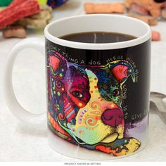 Ceramic coffee mug featuring colorful artwork inspired by dogs. Featuring graffiti style pop art by artist Dean Russo, this hot and cold drink cup is microwave safe, but hand washing is recommended. Makes a great gift for pet lovers. 11 oz. capacity. Measures 4.75